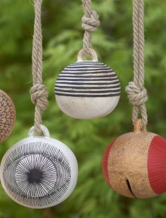 Garden Bells- Michelle Quan's stoneware bells and tree garlands carry a meditative, weighty spirit within them...
