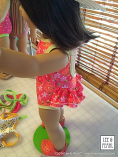 """American Girl Chrissa loves the cute back ruffle on her new swimsuit. This pattern will be the Lee & Pearl Newsletter """"Tweak"""" for June 2014. It uses both L&P #1051: Ballet Basics for 18"""" Dolls and L&P #1055 Skating Dresses for 18"""" Dolls. Sign up for our mailing list at www.leeandpearl.com to get the tweak and FREE Pattern #1051. Visit our Etsy shop at https://www.etsy.com/shop/leeandpearl for Pattern #1055."""