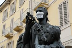 As the medical importance of face masks has increased during the pandemic, so has their symbolic value. Statues from Melbourne to Buenos Aires have been decorated with protective masks Greyfriars Bobby, Street Photography, Art Photography, Indian Scout, Wuhan, St Francis, Patron Saints, George Washington, Freddie Mercury