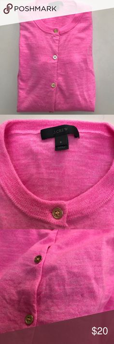 J Crew neon pink merino wool cardigan Worn a couple of times. There's a small hole in front and the price reflects the condition. Other than that there're no other defects. This is labeled as an S but fits more like an XS or an XXS. Please feel free to ask for measurements. J. Crew Sweaters Cardigans