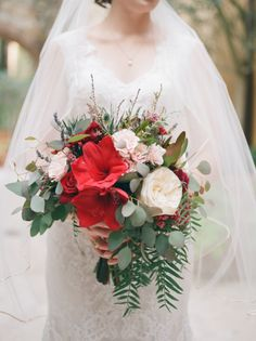Bridal bouquet with red amaryllis, blush garden roses, light pink spray roses, cascading greenery of eucalyptus and pepper berry. Jordan Weiland Photography