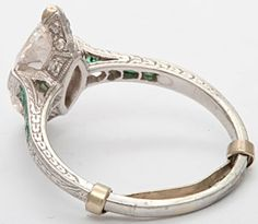 French art deco marquise diamond engagement ring with emeralds, set in platinum, c1920