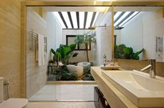 the connection between inside and outside can be even blurrier, such as with this shower and tub sharing an external space in Brazil. A cour...