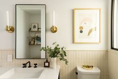 Convinced a white bathroom backsplash is a total bore? Here are some standout rooms that prove this bathroom staple is packed with excitement. Beige Tile Bathroom, Cream Bathroom, Bathroom Colors, Small Bathroom, Bathroom Ideas, Bathroom Remodeling, 1950s Bathroom, Retro Bathrooms, Yellow Bathrooms