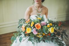 Flowing spring bouquet from a Sweet Southern Styled Shoot by Dandie Andie Floral Designs - Mississauga, ON    Floral Design: @dandieandiefloraldesigns  Photographer: @kate_pennings_photography  Planner & Design: @spunkysapphire  Makeup:  @makeup.by.elisha  Hair:  @makeuphairgorgeous  Jewelry: @hattitudejewels  Bridal Gown: @ferresposa  Venue: Ancaster Old Town Hall