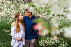 Kansas City Loose Park spring maternity session with the flowering apple tree Kansas City maternity photographer