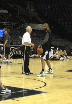 San Antonio @Irene Hoffman Naylor Coach Gregg Popovich & Tim Duncan chat before today's #NBAFinals practice.