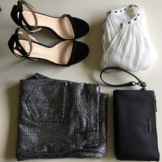 Super Cute Silver and Black Leggings Time to get funky! Super cute and comfy silver and black leggings. Brand new, never worn, but tag came off. Calvin Klein clutch and blouse sold in separate listings. Fabric: 51% Polyester 42% Cotton 7% Spandex. S (4-6). Pants Leggings