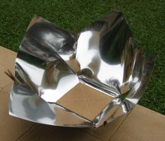 Copenhagen Solar Cooker Light - Solar Cooking - The four panels slip into the base instead of being laced to the base.