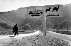 marc riboud(1923- ), road sign, khyber pass, afghanistan, 1955. gelatin silver print; printed c.1955, 6 1/2 x 10 in. howard greenberg gallery, new york, usa  http://www.howardgreenberg.com/exhibitions/marc-riboud-home-on-the-road#20
