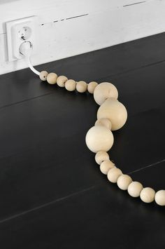 Hiding cable wooden balls...EASY and so much lovelier than looking at cords everywhere!