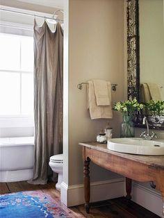 Earthy Bathroom--linen like curtain, slate floors, oatmeal walls