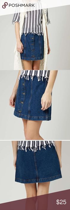 Topshop Moto denim skirt Topshop MOTO vintage wash denim skirt with a button front fastening. Cut in this season's must-have A-line silhouette; nipping in at the waist and gently flaring out on the leg. 100% Cotton. Topshop Skirts