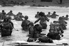 An LCVP disembarks troops of Company E, Infantry, Infantry Division (the Big Red One), wading onto the Fox Green section of Omaha Beach on the morning of June American soldiers encountered German Division when landing. D Day Normandy, Normandy Ww2, Normandy Invasion, The Big Red One, History Online, Bad Picture, American Soldiers, Second World, Vietnam War