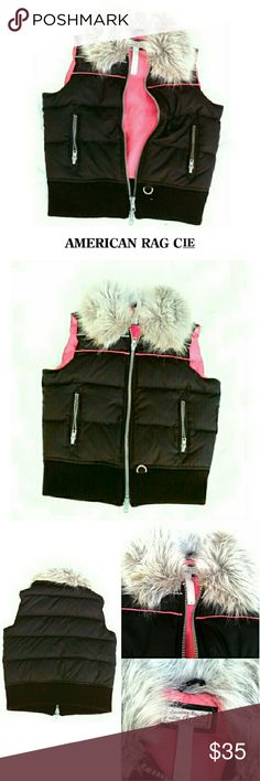 """💕HP 1/23/17💕AMERICAN RAG CIE  DOWN FAUX FUR VEST 💕HOST PICK 1/23/17💕 BEST IN OUTERWEAR PARTY Thank U @jassieboo92 AMERICAN RAG CIE BLACK & PINK PUFFER FAUX FUR VEST Pre-Loved  /Actual Pics Very Comfy Down Filled Pink & Black Puffer Vest Size Small *   Shell; 100% Polyester *   Lining; 100% Polyester *   FUR Trim; 100% Acrylic *   Filler; 45% Down Cluster 5% Down Fiber 50% Waterproof Feathers *   Machine Washable- Cold *   Some Inside Darkening Approx Meas; Chest; 19"""" L 21"""" Pls See All…"""