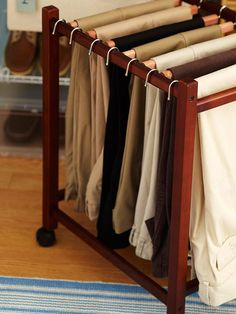 A Place for Pants        A rolling trolley for pants, left, adds an upscale touch to this closet portion, neatly organizing slacks on cedar posts.