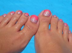 Shellac pedicure.  Cnd Tropix with a loose powdered glitter fade. Not a fan of the toe color, but LOVE the glitter!