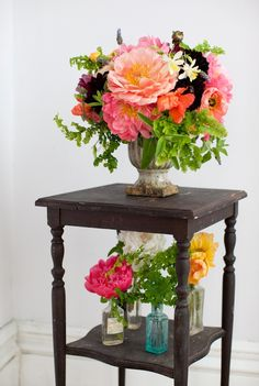 Just a bunch of maiden's hair fern in a vase, paired with a big peony, creates a powerful, lush effect.