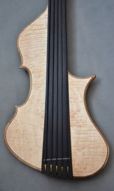 Marek Dąbek - Master Luthier Symphony Bass This is the upright bass sound and design enchanted to a bass guitar... Unique form, tehnical solutions and woods creates one of a kind instrument with most upright bass sound that you ever heard from a bass guitar...