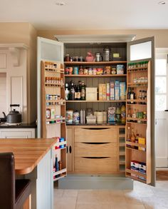 Harvey Jones Pantry Larder, with oak shelving, soft-close drawers, spice racks, removeable trays, wine rack and a granite cold shelf. www.harveyjones.com
