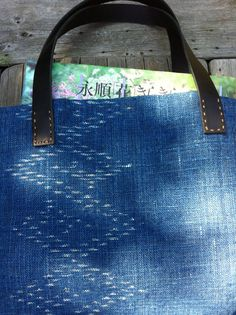 Indigo handspun cotton tote with leather handle. $78.00, via Etsy.