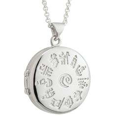 """An intriguing sterling silver locket designed with History of Ireland iconic symbols. The symbols, from Celtic High Crosses, tell the tale of various events from Ireland's rich past. Comes on an 18"""" chain."""