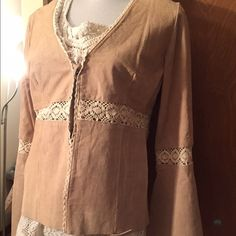 Leather Bohemian style top This ties in the front and also has inside clasps to close more if desired.  It has never been worn. Tops