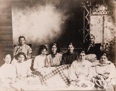 Cherokee women with Irish Chain quilt