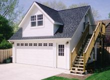 Custom 32x22 reverse gable garage with shed dormers for Reverse gable garage