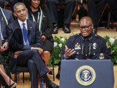 Powerful speech: US President Barack Obama listens to Dallas Police Department Chief David Brown during the Interfaith Tribute to Dallas Fallen Officers at the Morton H. Meyerson Symphony Center in Dallas - he extensively quoted from Stevie Wonder during his speech