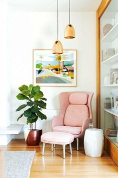 Pink midcentury armchair and ottoman corner, with copper pendant lights, a…