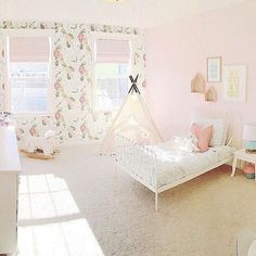 Sweet and feminine, this little girls toddler room mixes vintage and…