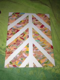 Put tape across a canvas in a argyle pattern. Then paint with fun summery colors for a summer painting. Once paint is dry remove tape and then you have a perfect painting.   I used acrylic paint for this project and that is the paint I suggest using.