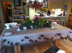 Main table for food and drinks for Camp/Outdoors Themed Baby Shower. Pine Cone garland