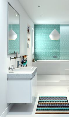 Love the soft blue tiled feature wall in this bathroom. #CaromaAustralia #LianoNexus #MissoniHomes