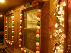 Outdoor Gingerbread house- large styrofoam balls cut in half and spray paint? Cute!!