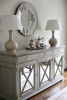 Credenza for dining room I hope I can find something like this - I love the mirrored doors. I want lots of mirrors opposite the window to brighten the room up.