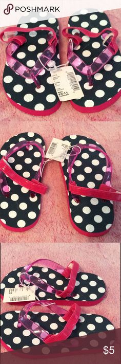 Children's Place Flip Flops Size 10-11 Toddler Blue and white polka dots with a hot pink strap and support strap for the little walkers. These flip flops are a size 10-11 Toddler and are brand new with tags. Children's Place Shoes Sandals & Flip Flops
