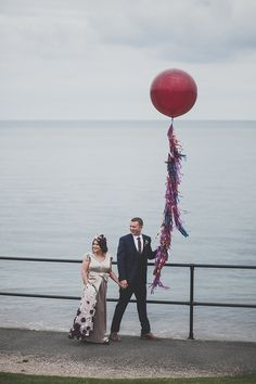 Red wedding balloon with coloured tassels    Photography by http://marymcquillanphotography.com/