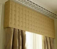 tufted cornice.  This will be our next project.  Love this idea - leather tuft with silk drapery!