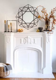 a stylish modern fall mantel with branches with berries, mini pumpkins on a gold stand and candles in candleholders Mantle Styling, Decor Inspiration, Decor Ideas, Living Room Decor Cozy, Fall Mantel Decorations, Mantel Ideas, Autumn Home, Interiores Design, Home And Living