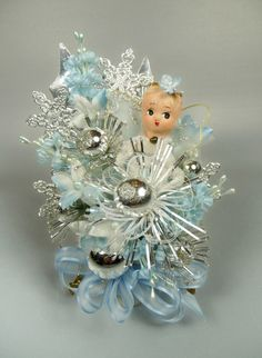 I remember Momma made sure we had one of these for our coats for church. Christmas Corsage Vintage Angel Pale Blue Silver Ice by meaicp