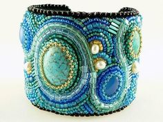 Beautiful beaded cuff in blues, turquoise and gold