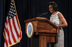 Mrs Obama wearing Peter Som pastel stripe dress.