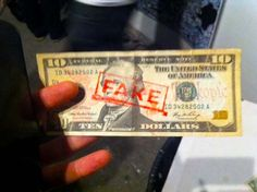 Counterfeit, 2012 Artist: Joshua Keay Description: Stamp, red ink, legal tender provided by viewer