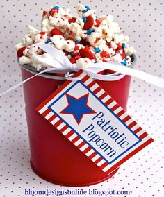 Patriotic Popcorn: pop a bag of Orville Reddinbacher's Tender White microwave popcorn, sift out any un-popped kernels and lay flat on baking sheet.  Melt a couple oz of white chocolate and drizzle on top.  Sprinkle on red and blue sprinkles and top with patriotic M&Ms.  Allow to cool for 1 hr and then break apart.  (can't find any quantities, eyeball it and see how it turns out!)