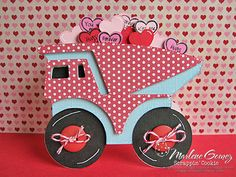 """The Dump Truck is from the B is for Boy Lite Cartridge. Use the Cricut Craft Room (or Gypsy) to weld two Dump Trucks together to form the card base. Weld 2 different sized hearts from the Create ACritter Cartridge (pg 64)to the Dump Truck Shift layer. The small hearts were sized to .708""""W x .653""""H and the larger ones to .75""""W x .681""""H."""