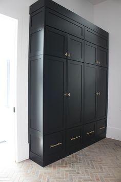 herringbone flooring Beautiful storage ideas in mudroom with black cabinets Küchen Design, House Design, Mudroom Cabinets, Floor To Ceiling Cabinets, Laundry Room Storage, Laundry Closet, Small Laundry, Laundry Rooms, Thin Brick