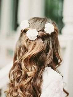 Half up, half down hair with floral decorations: http://www.stylemepretty.com/little-black-book-blog/2014/12/19/whimsical-elegant-charlotte-wedding/ | Photography: Lauren Rosenau - http://www.laurenrosenauphotography.com/