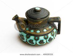 Jerusalem ceramic teapot with glazed inserts of aquamarine color.Retro style of 50th years